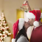couples kiss under the mistletoe