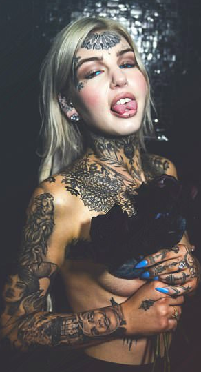 woman with tattoo and split tongue